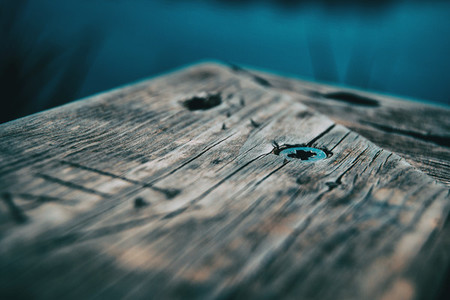 old wooden plank with screws
