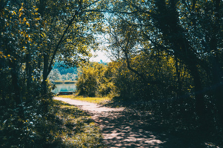 wooded path around lake banyoles spain