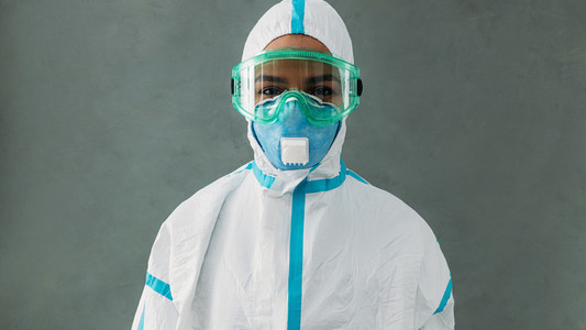 Portrait of a female nurse in protective wear with mask