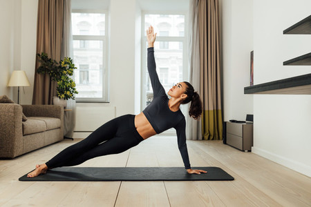 Woman in sports clothing doing workout at home