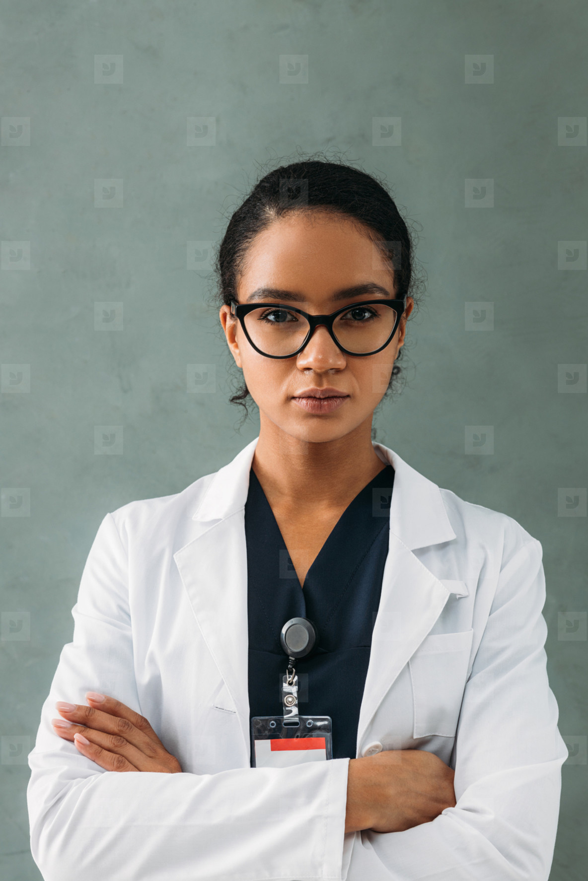Portrait of a serious medical worker standing with crossed arms