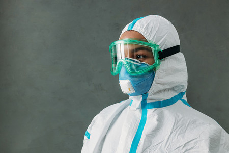 Close up of medical specialist in a protective suit with a respirator