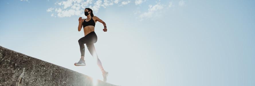 Woman doing running workout in morning