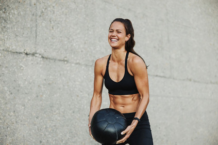 Woman working out with a medicine ball