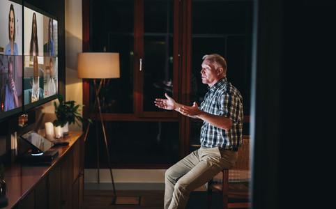 Entrepreneur having a online meeting with team