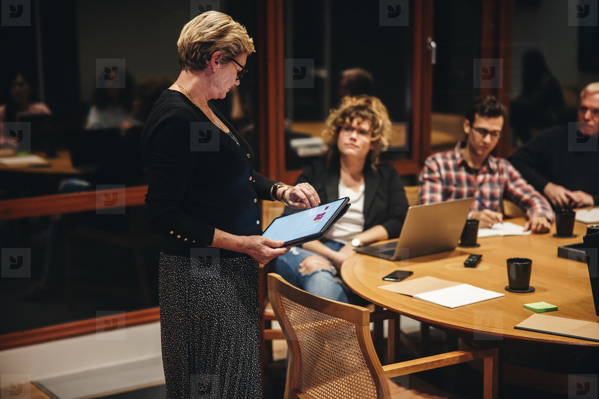 Businesswoman checking time during a meeting