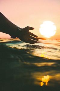 Silhouette hand shape sunset