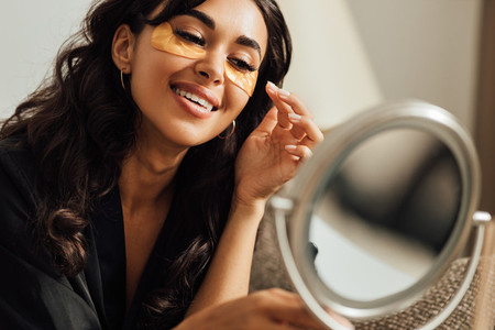 Close up of beautiful brunette looking at mirror