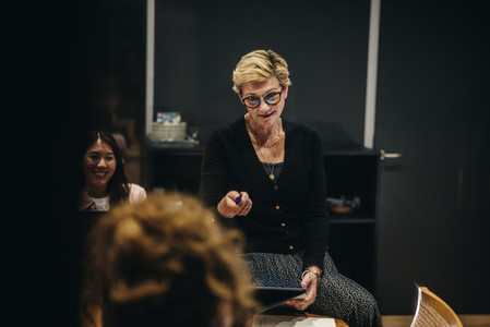 Female CEO giving instructions in meeting