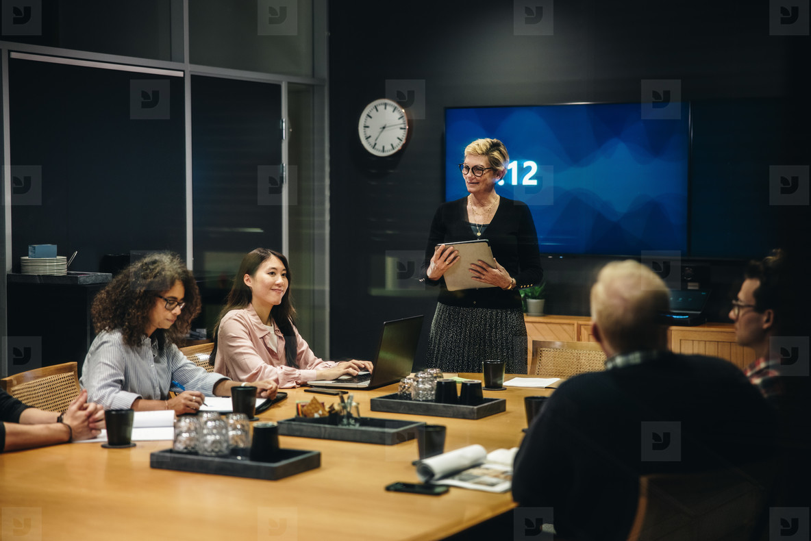 Female manager addressing her team at a meeting