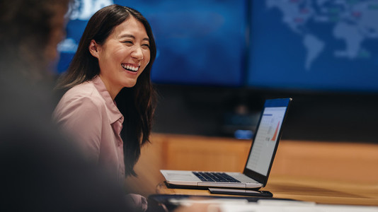 Businesswoman smiling in office meeting