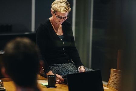 Businesswoman with digital tablet in meeting room