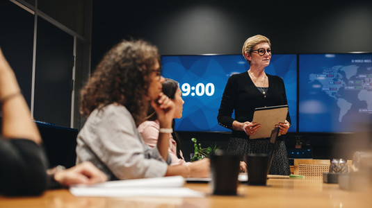 Businesswoman addressing boardroom meeting