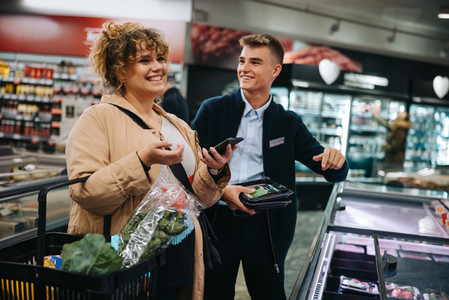 Happy woman customer shopping in supermarket