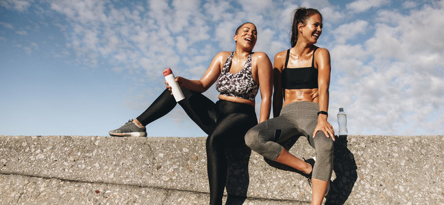 Fitness women resting after workout