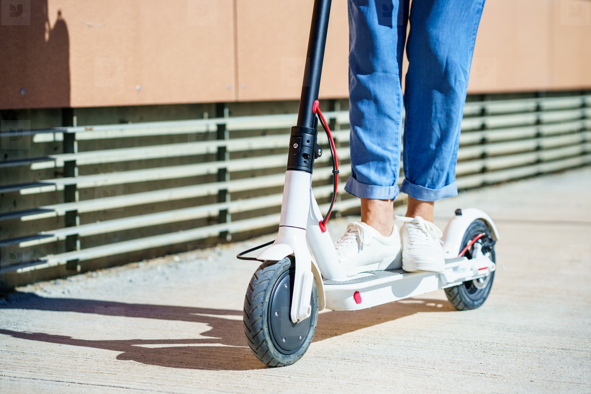 Woman circulating in the city with an electric scooter