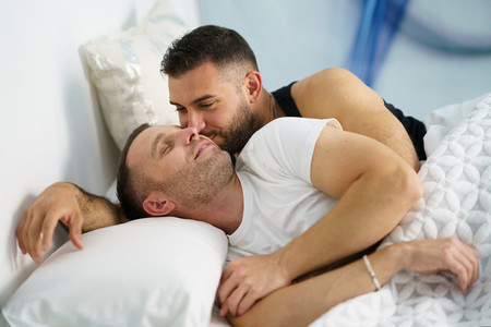 Gay couple in a romantic moment in bed