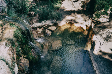 landscape with a pool with waterfall in a place of spain