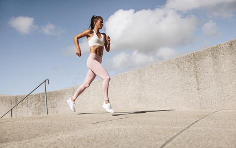 Female athlete running in the morning