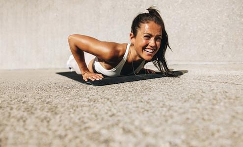 Woman enjoying doing exercise outdoors