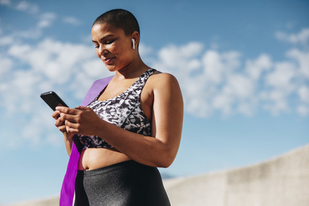 Health woman checking her fitness progress on smart phone
