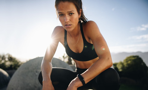 Woman sitting outdoors after her workout