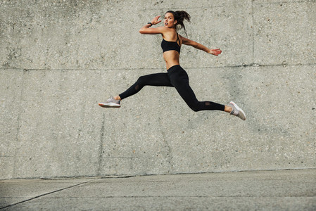 Sporty woman exercising outdoors