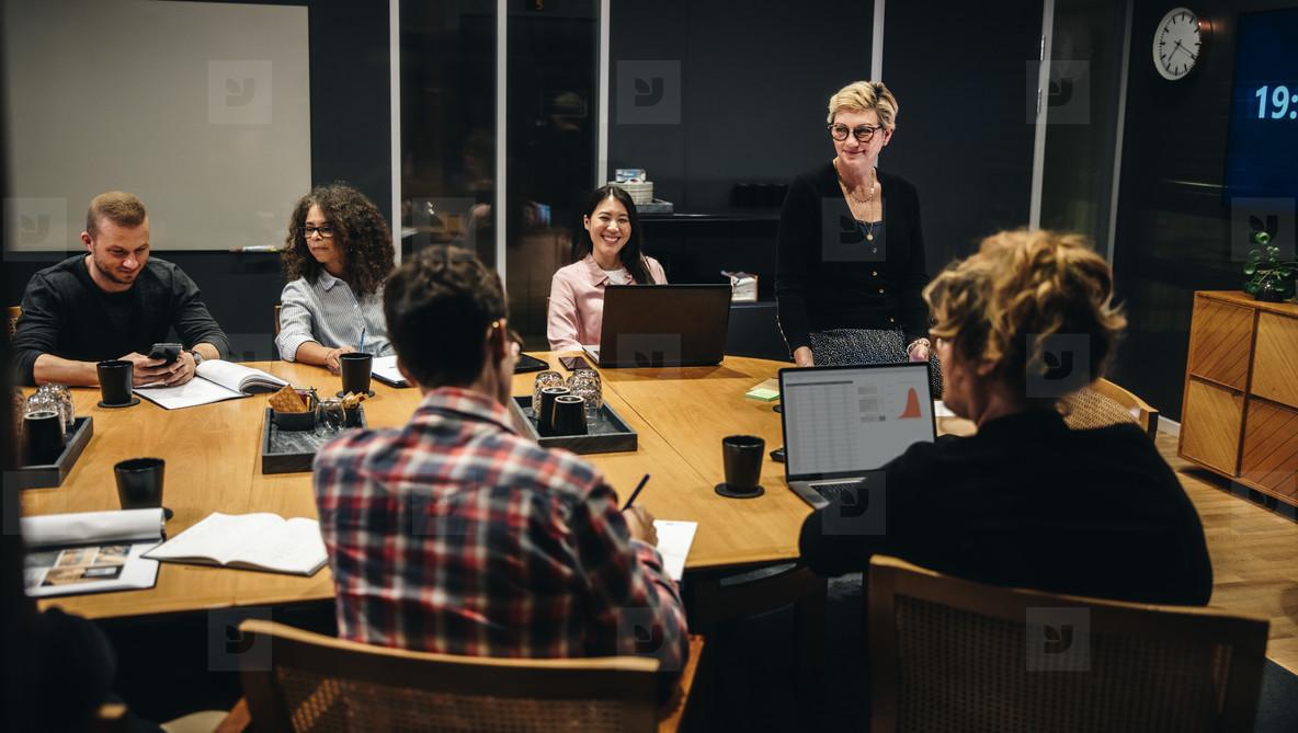 Woman taking lead in boardroom meeting
