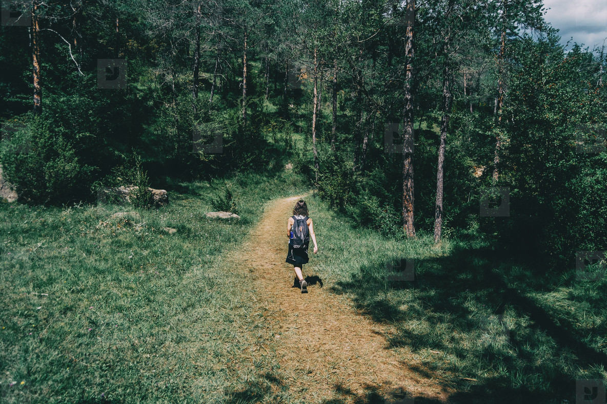 woman walking along a small path