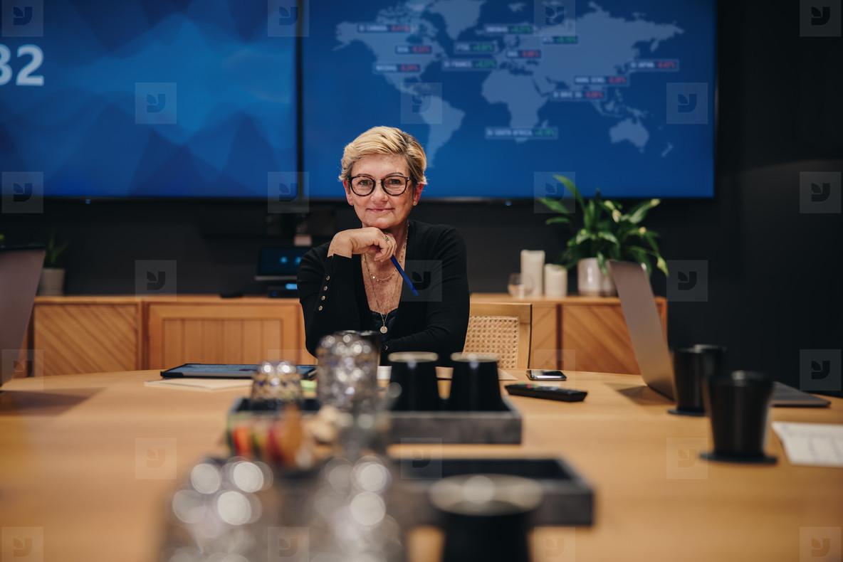 Confident female entrepreneur in meeting room