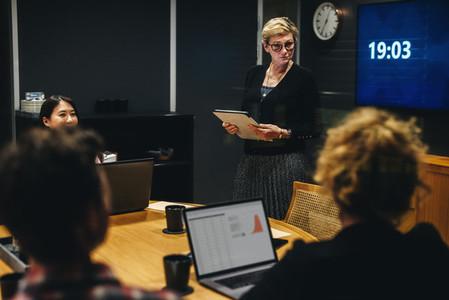 Staff briefing in office boardroom