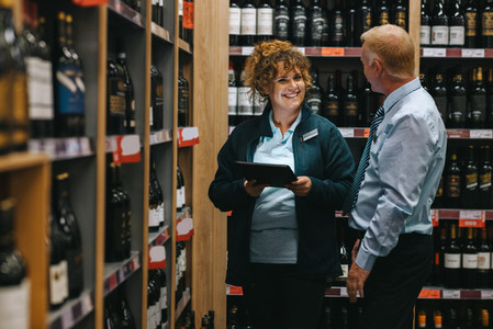 Supermarket manager discussing with connoisseur