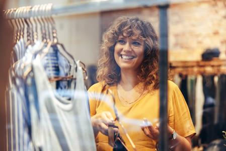 Saleswoman setting up fashion store display