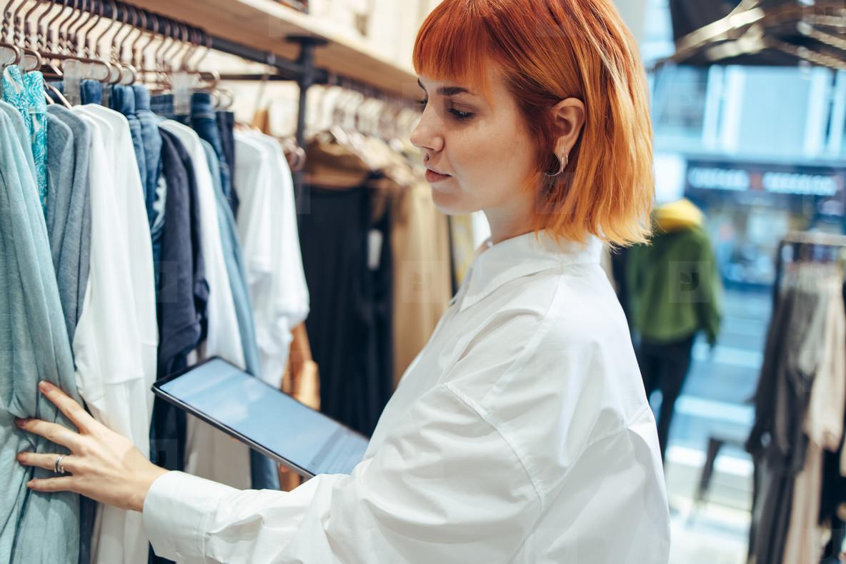 Fashion store owner taking stock