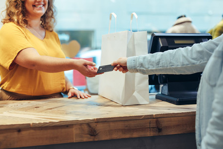 Customer paying for purchases in clothing store