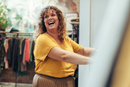 Happy shopper in clothing store