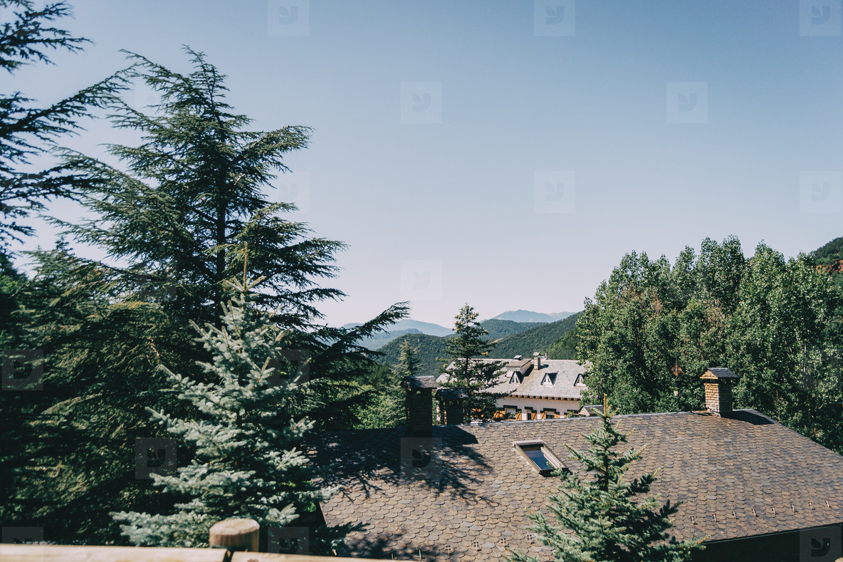 View from above of several rooftops of a rustic town located in Catalonia  Spain  The day is sunny with a cloudless blue sky
