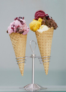 Ice cream and sherbet with toppings in waffle cones