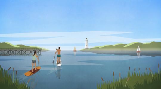 Couple stand up paddleboarding on idyllic summer lake