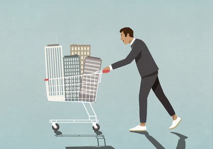 Businessman pushing skyscrapers in shopping cart