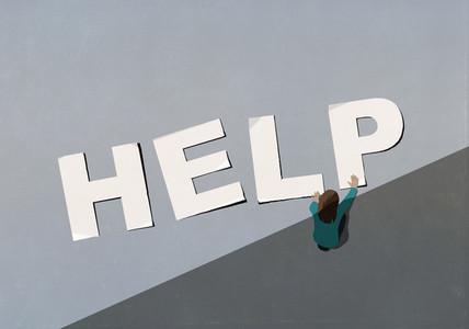 Woman arranging Help letters