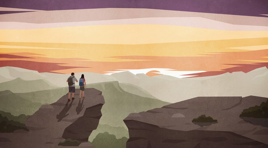 Couple hiking and enjoying scenic majestic mountain view at sunset