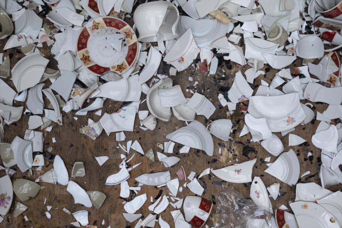 Broken dishes scattered on floor