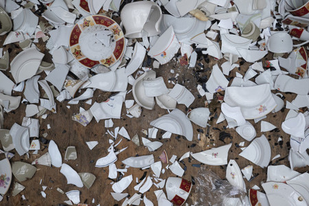 Broken dishes scattered on floor