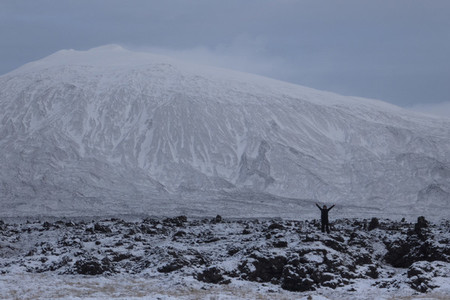 Exuberant woman in remote snowy mountain landscape