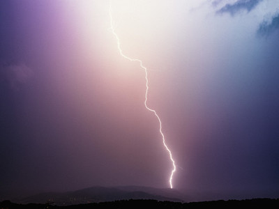 Lightning bolt in majestic stormy sky