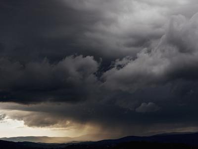 Dark gray storm clouds over landscape