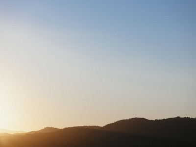 Tranquil blue sunset sky over silhouetted hills