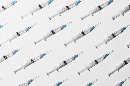 COVID 19 vaccine syringes on white background