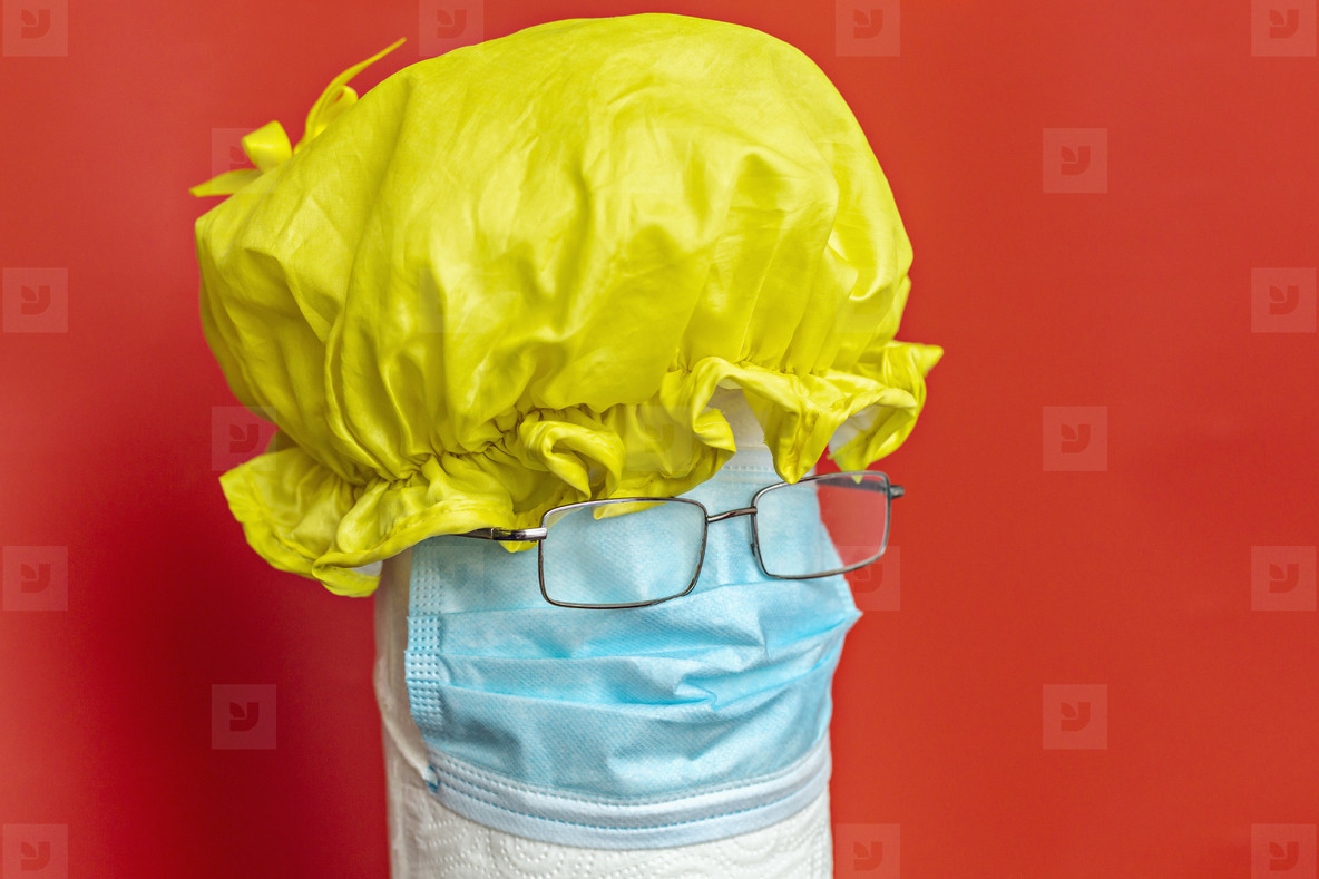Shower cap protective face mask and eyeglasses forming anthropomorphic face